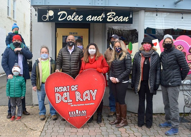Dolce & Bean owner Petros Ghebre-Egziabher, center, was presented with the Heart of Del Ray award Feb. 12.