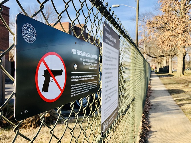 Signs like these went up across the city last year after the General Assembly gave local governments authority to regulate guns.