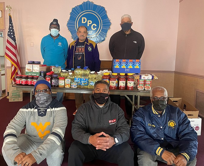 Departmental Progressive Club president Nelson Green Jr., center back, with DPC members at the club's Feb. 20 food drive. Pictured clockwise from back left: Joseph Jennings, Nelson Greene Jr., William Chesley, Daniel Shelby, Willie Bailey and Bill Campbell.