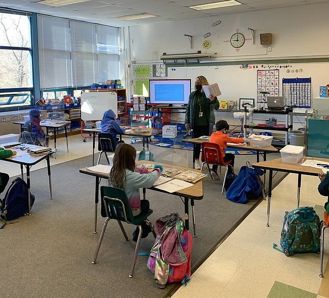 Welcoming young students back to Jamestown Elementary in Arlington. Here is a peek inside Ms. Kalchbrenner's 1st grade class.
