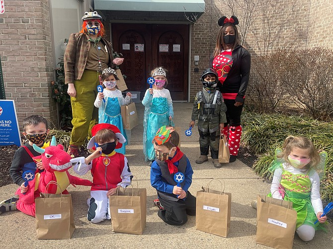 Teachers Charlotte Buckhold and Brandy Smith with the kitah sagol (purple class) in their costumes and Mishloach Manot, bags of goodies celebrating Purim at Agudas Achim Congregation Feb. 26.