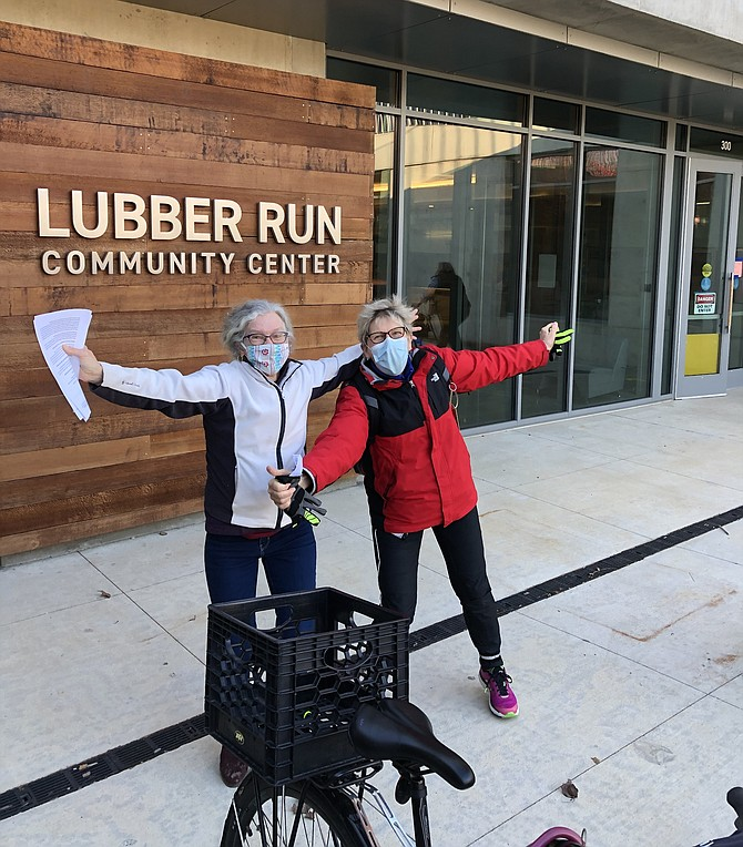 The reporter joins Karen Gerstbrein in jumping for joy after the jab at Lubber Run.