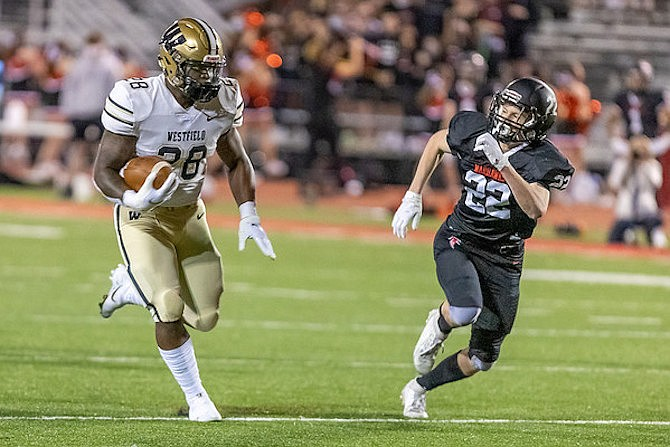 Mikal Legall #28 tries to evade Madison's John Hurley #22.