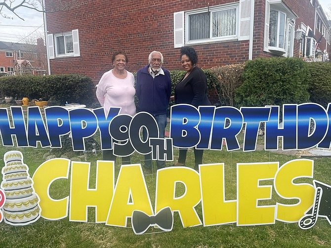 Charles Nelson, center, celebrates his 90th birthday March 11 at his home in Alexandria with daughter Gail Nelson and granddaughter Shaye Nelson.