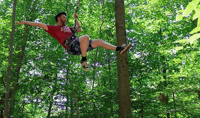 Flying through the Go Ape course in Fairfax County.
