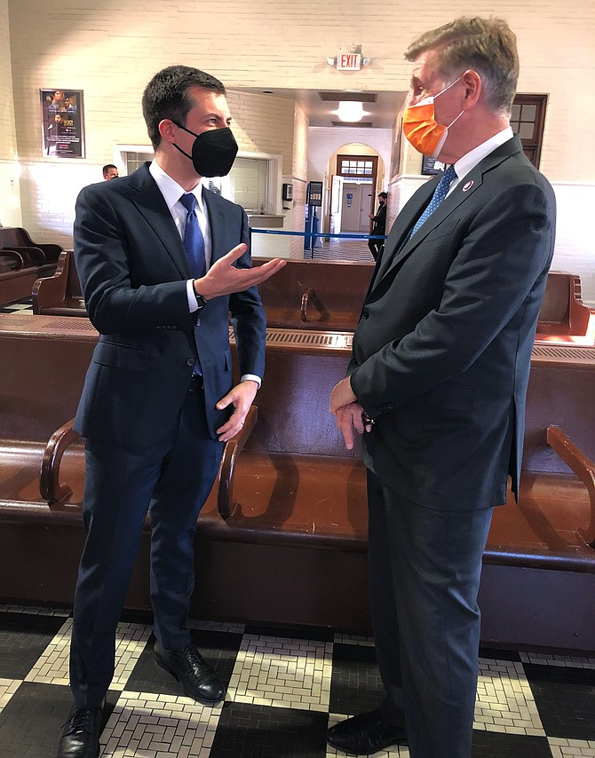 Peter Buttigieg, U.S. Secretary of Transportation, talks with U.S. Rep. Don Beyer in Alexandria on Tuesday, March 30.