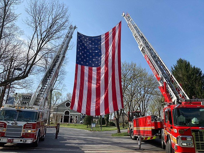 Fire and rescue personnel prepare to honor Cabin John Park Volunteer Fire Department's Stephen Miller before the memorial celebration of his life at Our Lady of Mercy on Tuesday, April 6, 2021.