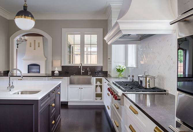 This kitchen, created by designers at Anthony Wilder Design/Build, features a Caesarstone island and Silestone perimeter.