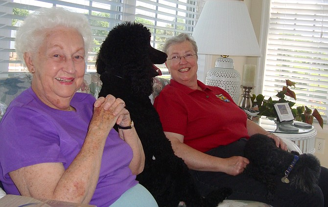 Alexandria resident Pam Matthes (right) with her mother, Pat. And in the middle, a big nosy poodle named Phoebe.