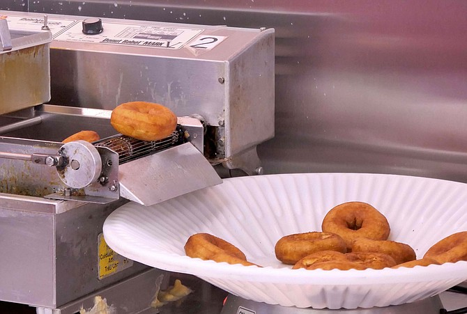 Duck Donuts fall into hot fat in front of your eyes and can be customized with your choice of coating, topping and drizzle.