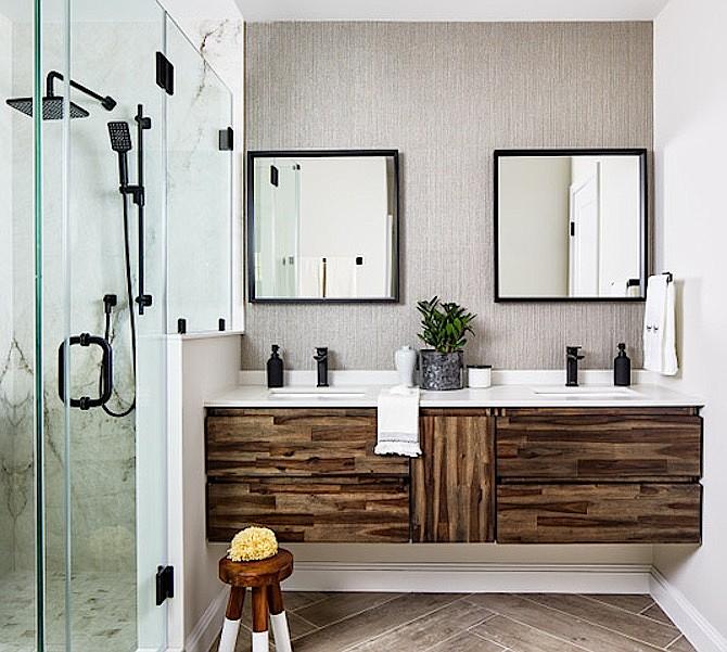White countertop, dark wood cabinets, floating vanity, black fixtures create a spa-like atmosphere in this bathroom by InSite Builders & Remodeling.