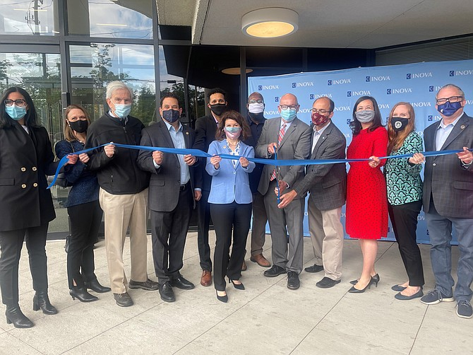 Alexandria and Northern Virginia elected officials help Inova President and CEO Dr. J. Stephen Jones, fifth from right, cut the ribbon to officially open the Inova Cares Clinic for Women May 8 in Alexandria.