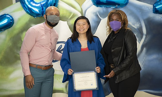 Marymount University's  first Cultural Graduation Reception acknowledges the accomplishments of first-generation college graduates from underrepresented groups in an intimate and inclusive environment. Graduate Anna Moon, center, receives her Cultural Graduation certificate alongside Dean Brooke Berry, right, and Associate Director Tait Brooks.