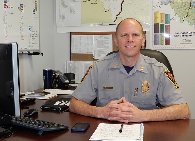 Police Capt. Jason Allegra at his desk at the Sully District Station.