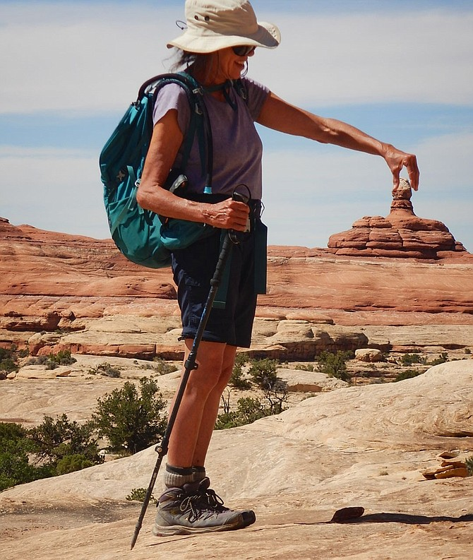 Travel enthusiast Arlene Richter, pictured here in the Needles district of Utah's Canyonlands National Park, is fully vaccinated and ready to resume her travels.
