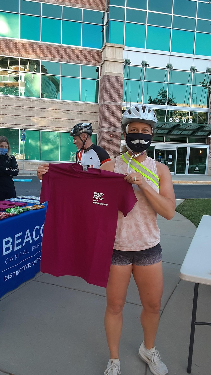 Kingstowne resident Aspen Guthrie and her Bike to Work Day tee shirt.