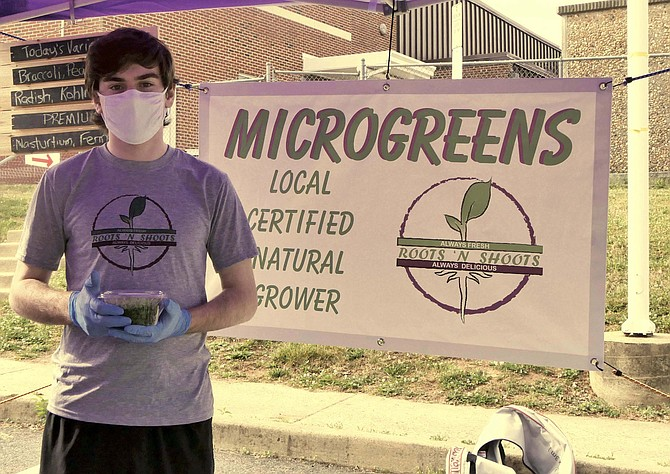 Diego Gomez, home from UVA for the summer, is helping staff his mom's Roots & Shoots microgreens stand at Lubber Run Farmer's Market on Saturdays from 8 a.m.-noon.