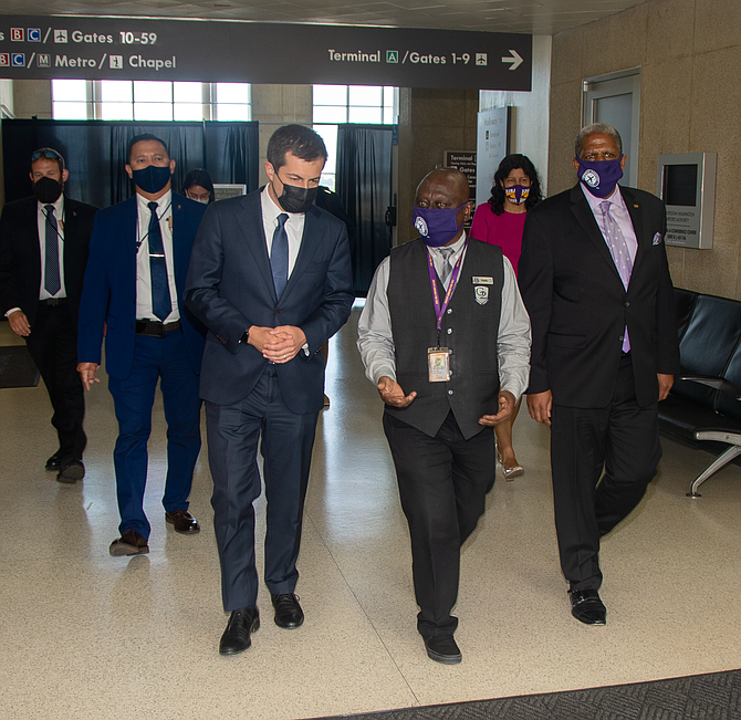 Kwaku Agyeman, an Alexandria resident,  talked to U.S. Secretary of Transportation Pete Buttigieg about airport workers' fight for paid sick leave and health care from MWAA.
