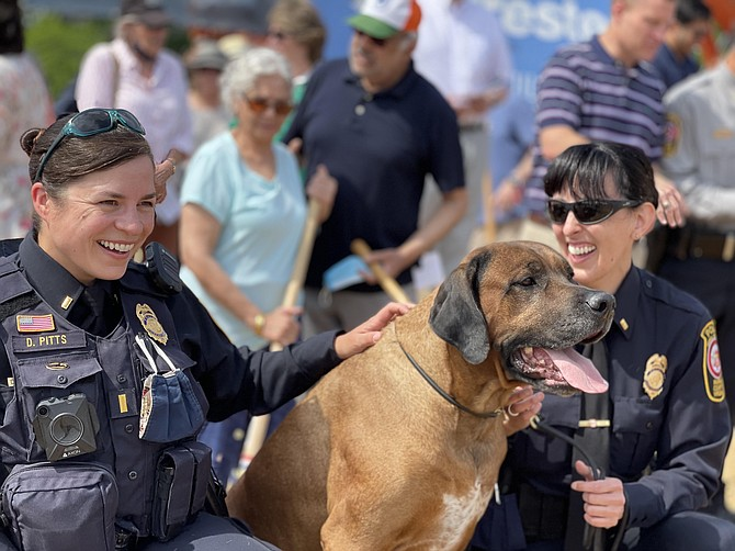 Animal Protection Police Officers D. Pitts, Wallace, and K. Prucnal share a moment during the ceremony heralding coming improvements to animal services in the county.