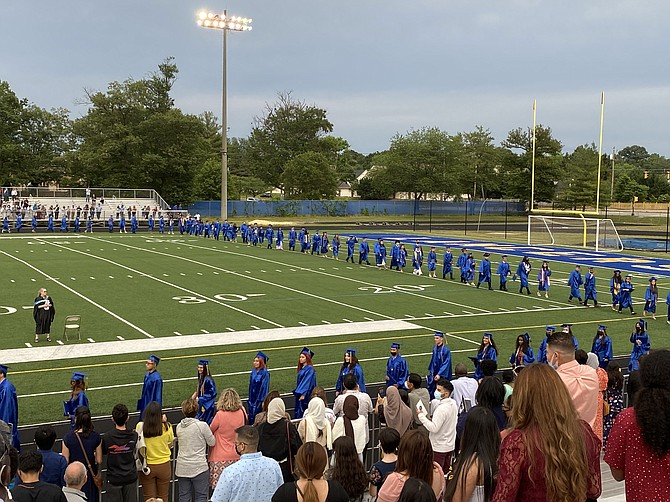 The class of 2021 takes a victory lap around the football field, becoming the first official graduates of John R. Lewis High School.