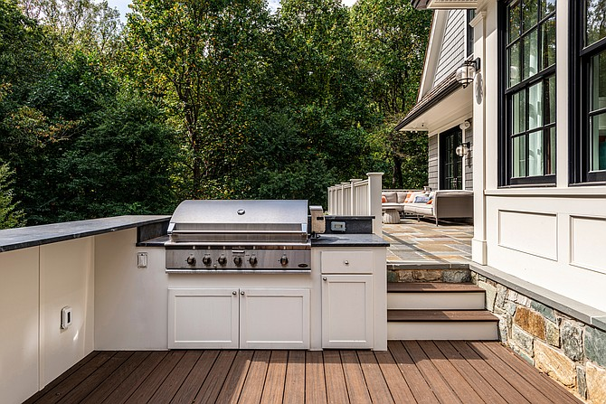 The outdoor deck kitchen of this McLean home, designed by GTM Architects.