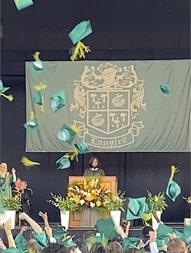 Officially announced graduates, the Langley High School Class of 2021 throws their caps in the air, symbolically ending a chapter in the graduates' lives.
