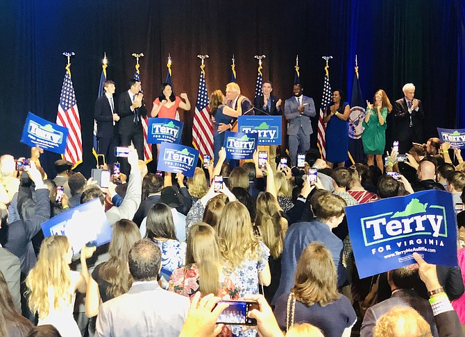 Democrats celebrate former Gov. Terry McAuliffe's victory Tuesday night in McLean.