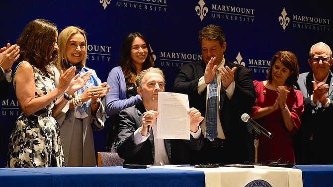 Sen. Jennifer Boysko; President Irma Becerra; Karla Mercado Dorado, sophomore at Marymount University; Gov. Ralph Northam; Del. Alfonso Lopez; Sen. Barbara Favola.