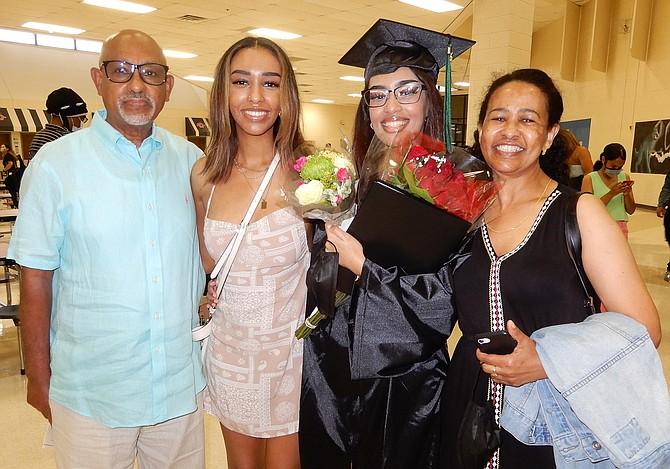 (From left) dad Solomon Tekola, sister Eden Solomon, grad Eve Solomon and mom Menbere Wija.