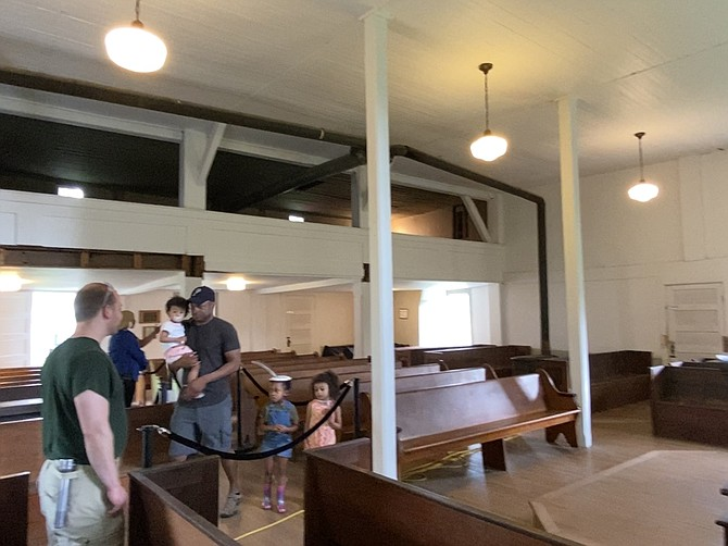 The inside of the Frying Pan Spring Meeting House on Centreville Road with one of the intact galleries where Black members of the congregation sat, segregated from the white members who sat on the main level.