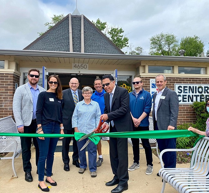 Ribbon cutting to celebrate the renovation of St. Martin de Porres Senior Center. Stephen Carattini, President and CEO of Catholic Charities, cuts the ribbon with officials from HomeAid Northern Virginia, Northfield Construction & Development, Trinity Group Construction and Catholic Charities.
