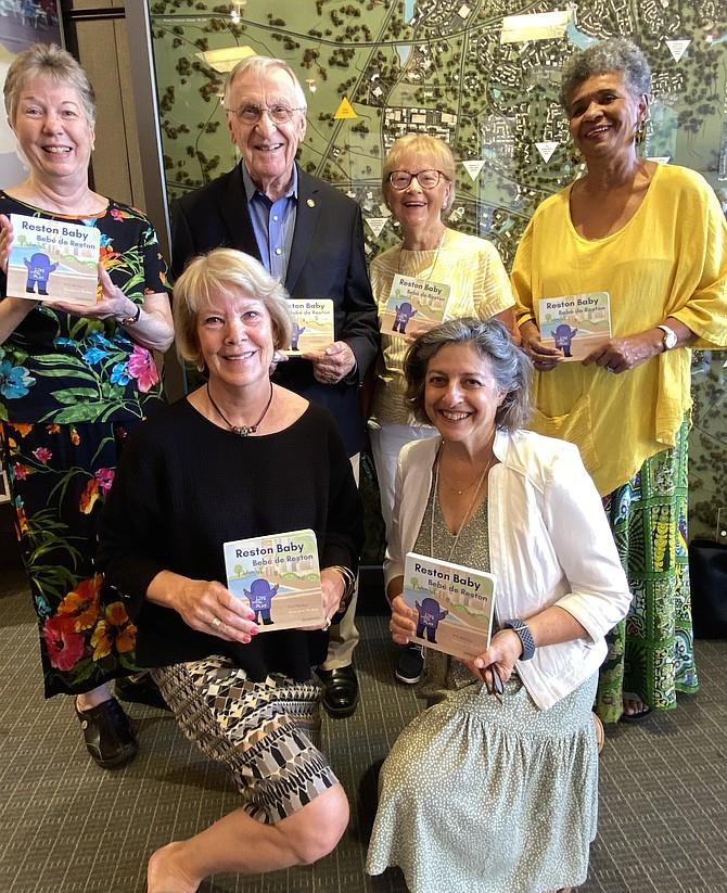 (From bottom left to top right) The Reston Reads Team: Dr. Elizabeth English, Roberta Gosling, Kathy Leatherwood, Delegate Ken Plum, Pat Fegi, and Carol Bradley.
