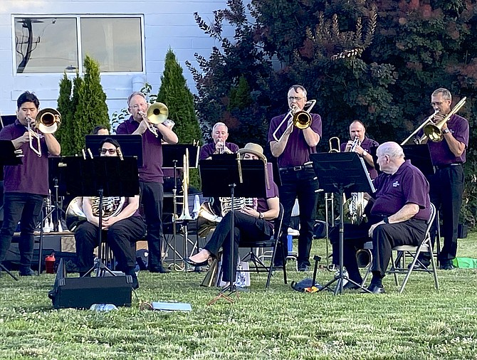 """The """"Cathedral Brass of Vienna Presbyterian Church"""" performs on the Arts Herndon Lawn Stage, part of the Arts Herndon's World Music Series."""