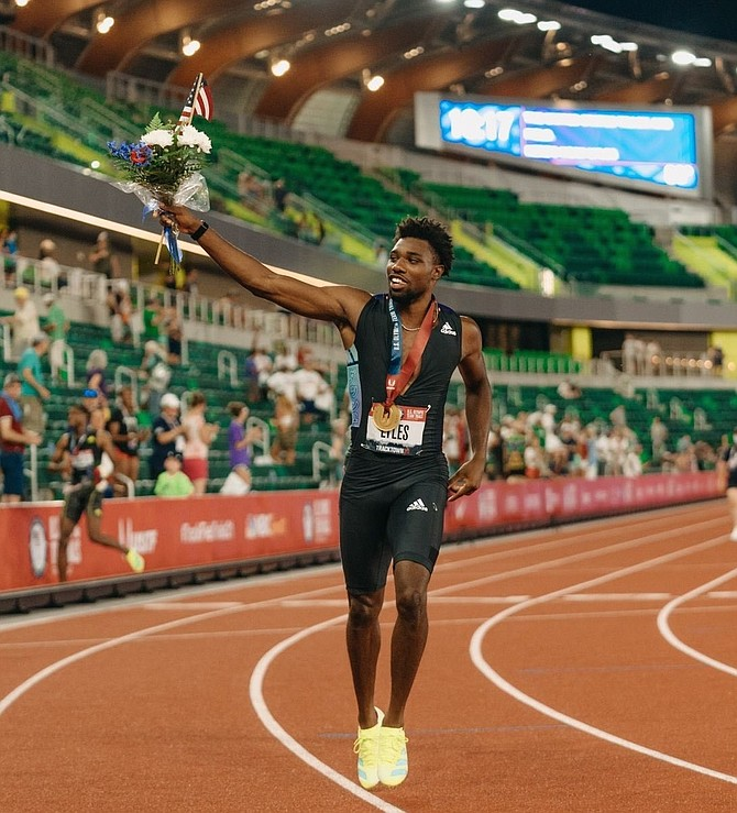 Alexandria native Noah Lyles celebrates after taking home the gold medal in the 200 meters during the U.S. Olympic Track & Field trials June 27 in Eugene, Ore. Lyles finished in 19.74 seconds — the fastest time in the world this year — and will compete this July at the Tokyo Olympics.