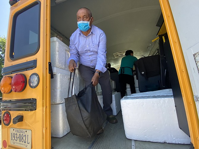 Coolers full of 7-day meal kits, planned by registered dietitian nutritionists and prepared daily by trained food service professionals pack a Fairfax County Public School bus for its Bus Route Meal Service, Summer 2021.
