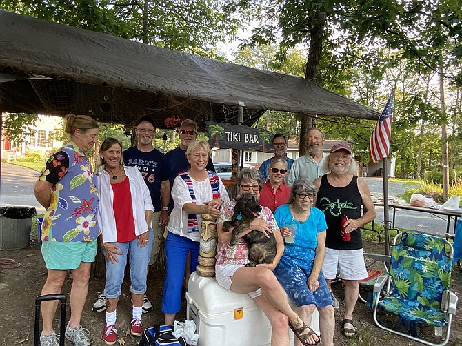 """Neighbors and friends in the Town of Herndon gather in their Bower Lane cul-de-sac, lovingly called """"the island,"""" to celebrate the 4th of July with a community picnic. Town Mayor Sheila Olem (second row, third from left) enjoys the festivities."""