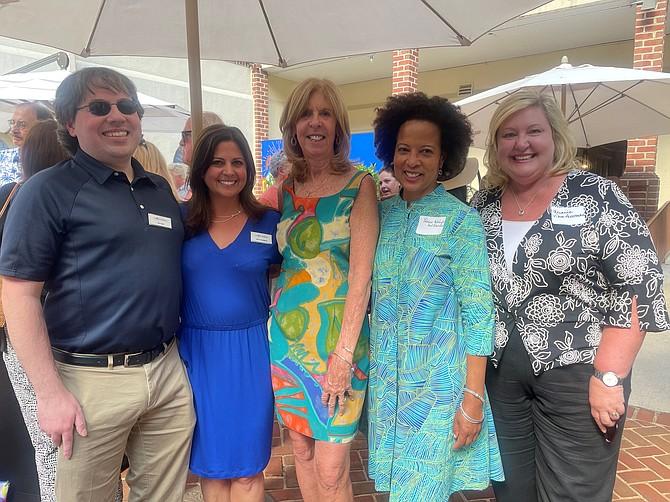 Lorraine Lloyd, center, celebrates her retirement from Visit Alexandria with co-workers Vita Fiore, Nancy Rosenbaum, Patricia Washington and Melanie Fallon June 23 at The Alexandrian Hotel.