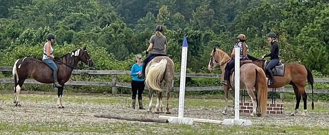 Riders Anne McFarland, Fairfax; Jeanne Hechmer, Fairfax Station; Kim Cook, Woodbridge; and Sarah McClaflin, Leesburg receive course instructions from Melissa Smith.