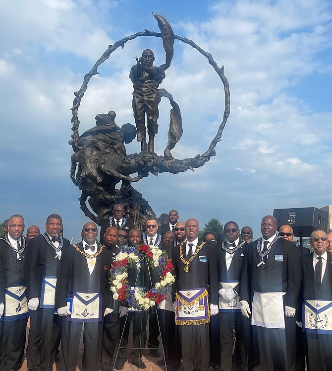 Members of the 31st Masonic District gather in front of the Contrabands and Freedmen Cemetery Memorial during the July 24 dedication of the site's inclusion in the African American Civil Rights Network.