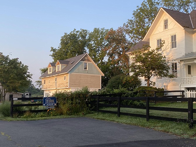 (From left) The Turner Farm garage is located behind the main farmhouse. It will be used as a public benefit association facility providing meeting space for grief and bereavement programs.