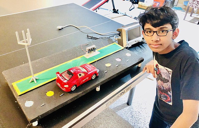A project about sending energy through the road to electric cars led to Kriesh Tivare of McLean, seventh-grader at Cooper Middle School, becoming a State Merit Winner.