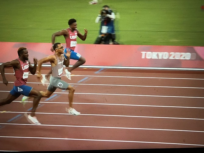 Canada's Andre de Grasse, center, races for the gold medal ahead of Americans Kenneth Bednarek, left and Noah Lyles.