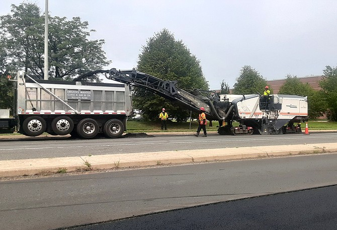 The crews here are scraping the old pavement up, and sending it back to the plant where it gets remixed as recycled asphalt.