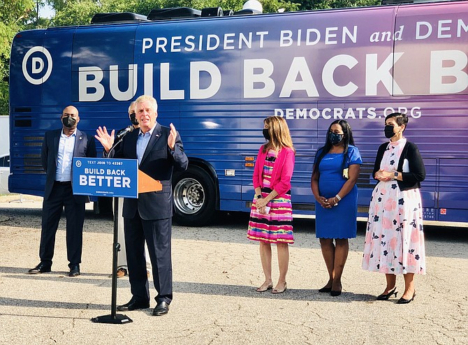 Former Gov. Terry McAuliffe is flanked by Democratic National Committee Chairman Jaime Harrison, Sen. Dave Marsden (D-37), House Speaker Eileen Filler-Corn, Majority Leader Charniele Herring and candidate for lieutenant governor Del. Hala Ayala (D-51).
