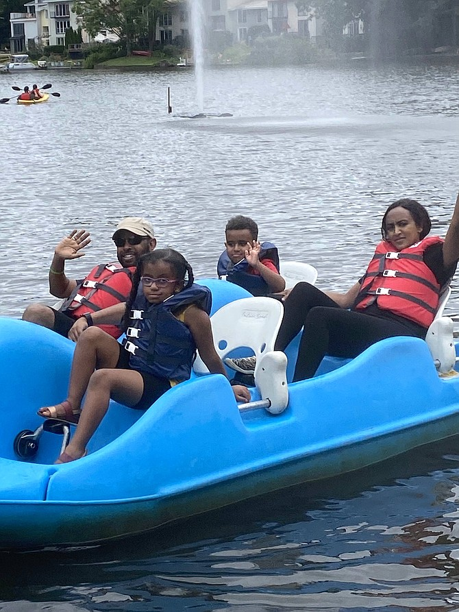 The Tekle family on Lake Anne in Reston wave goodbye to summer.