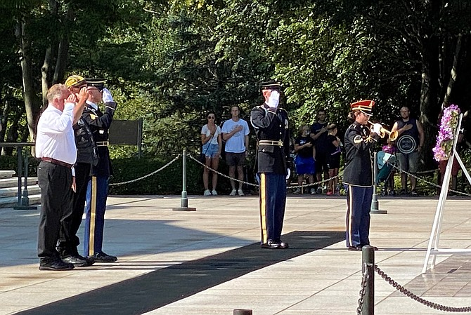 Warren Williamson, left, salutes during the playing of Taps following a wreath laying ceremony by members of the Tribute to Fallen Soldiers Northwest Motorcycle Ride at the Tomb of the Unknowns Aug. 8 at Arlington National Ceremony.