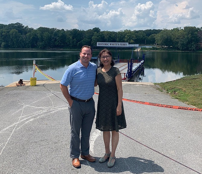 Councilmember Andrew Friedson and Del. Lily Qi stand in front of idled White's Ferry at a meeting of local, state and federal representatives working to reopen the ferry.