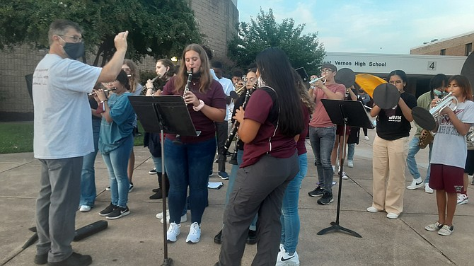 The Mount Vernon High School band provides the sounds for the first day of school in Fairfax County.