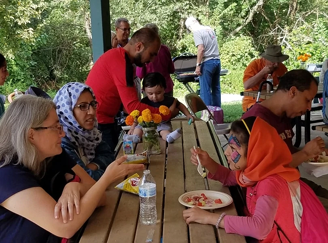 A picnic for Afghan families held at Chinquapin Park in Alexandria by Christ Church in Alexandria with Rock Spring UCC in Arlington.
