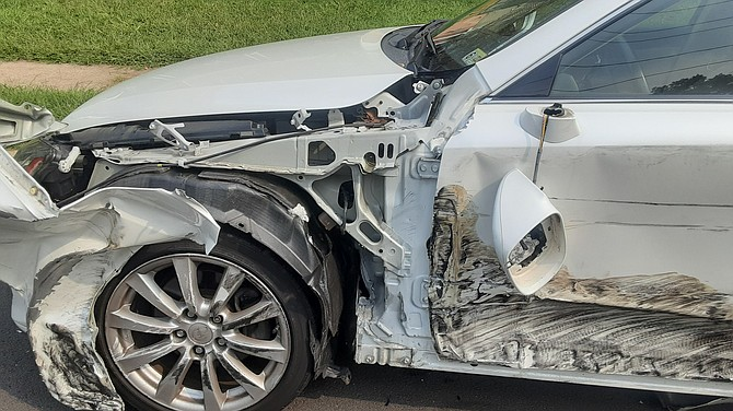 The police were called after this parked car was hit on Rolling Road.